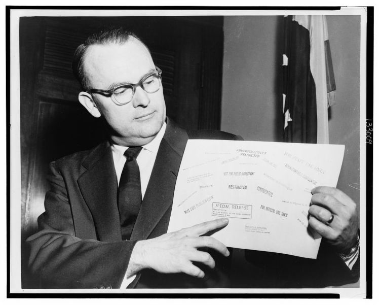 In 1958, Rep. John E. Moss (D-Calif.) displays the secrecy stamps that appear on classified government documents. / Library of Congress